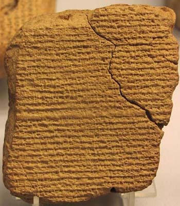 What language replaced cuneiform writing and why?