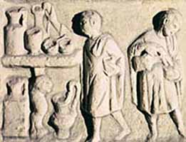 A carving of Roman Slaves doing house work.